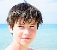 Adorable happy smiling little boy on beach vacation Stock Image