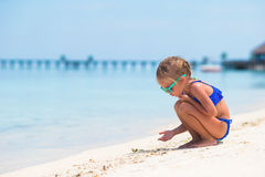 Adorable happy smiling little girl on beach Stock Image