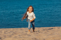 Adorable happy smiling little girl on beach Royalty Free Stock Image