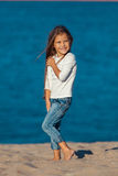 Adorable happy smiling little girl on beach Stock Photography