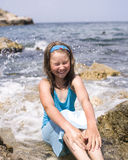 Adorable happy smiling little girl on beach vacation Royalty Free Stock Image