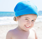 Adorable happy smiling little girl on beach vacation Stock Photos