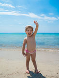 Adorable happy smiling little girl on beach vacation Stock Images