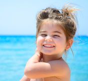Adorable happy smiling little girl on beach vacation Stock Image