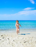 Adorable happy smiling little girl on beach vacation Royalty Free Stock Photos