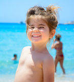 Adorable happy smiling little girl on beach vacation Royalty Free Stock Photo