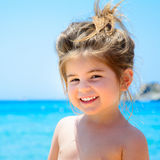 Adorable happy smiling little girl on beach vacation Royalty Free Stock Photography