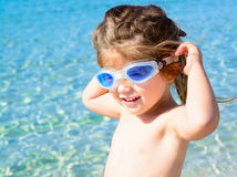 Adorable happy smiling little girl on beach vacation Stock Photo