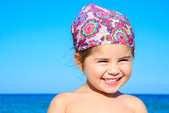 Adorable happy smiling little girl on beach vacation Royalty Free Stock Images