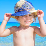 Adorable happy smiling little girl on beach vacation Stock Photography