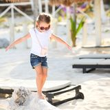 Adorable happy smiling little girl on beach Stock Photos