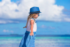 Adorable happy smiling little girl in hat on beach Royalty Free Stock Photography