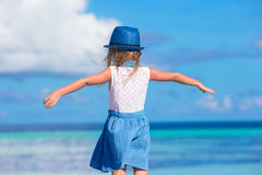 Adorable happy smiling little girl in hat on beach Royalty Free Stock Image