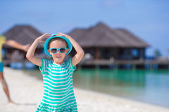 Adorable happy smiling little girl in hat on beach Royalty Free Stock Images