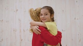 Adorable happy teenage girls standing and hugging stock footage