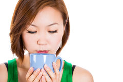 Adorable happy woman drinking her tea. Stock Image