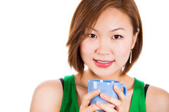 Adorable happy woman drinking her tea. Royalty Free Stock Photography