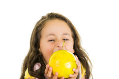 Adorable healthy little girl eating a passionfruit Royalty Free Stock Photos