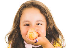 Adorable healthy little girl holding a carrot in Stock Image
