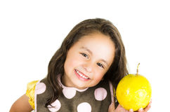 Adorable healthy little girl holding a yellow Stock Photography