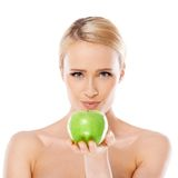 Adorable and healthy woman holding apple Stock Photo