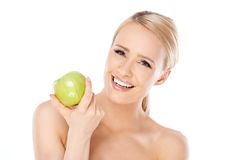 Adorable and healthy woman holding apple Stock Image