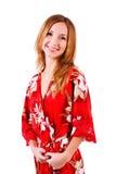 Adorable hermoso en vestido rojo del resto Fotografía de archivo