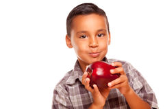 Adorable Hispanic Boy Eating a Large Red Apple Royalty Free Stock Images