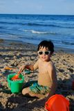 Adorable Hispanic boy by the pool Royalty Free Stock Photo