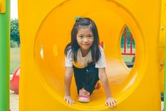 Adorable and Holiday Concept : Cute little child feeling funny and happiness on playground. stock photo