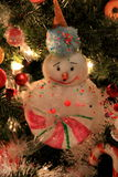 Adorable holiday snowman ornaments and lights on Christmas tree Royalty Free Stock Photos