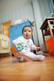 Adorable infant plays in the room, soft focus Royalty Free Stock Photos