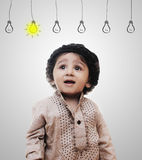 Adorable Intelligent Little Boy Thinking - Idea Bulbs Royalty Free Stock Images