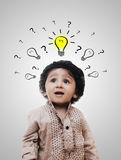 Adorable Intelligent Little Boy Thinking - Question Marks Stock Photography