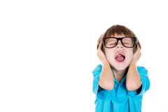 Adorable kid with black glasses covering ears as if something is loud or he doesn't want to hear something Royalty Free Stock Photo