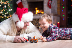 Adorable Kid Boy And Father Playing With Cars Toys At Home In Christmastime. Happy Child Having Fun With Gifts. Colorful Stock Image