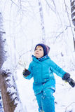 Adorable kid boy having fun with snow outdoors Royalty Free Stock Photo
