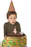 Adorable kid celebrating his birthday royalty free stock image