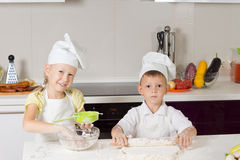 Adorable Kid Chefs Baking Something to Eat. In the Kitchen Royalty Free Stock Photography