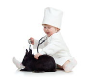 Adorable kid with clothes of doctor and pet bunny Stock Image