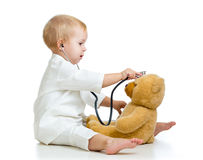 Adorable kid with clothes of doctor and teddy bear Stock Images