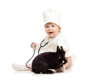Adorable kid doctor with pet rabbit Stock Image