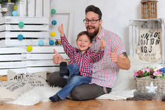 Adorable kid. Family. Adorable kid and his father Royalty Free Stock Photo