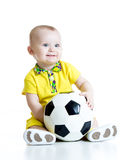 Adorable kid with football over white background. Adorable kid with football isolated white background Royalty Free Stock Photography