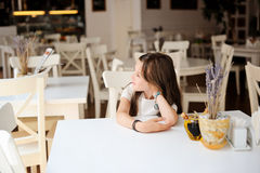 Adorable kid girl in cafe Stock Photos