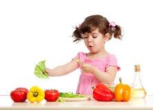Adorable kid girl preparing healthy food stock photography