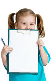Adorable kid girl uniformed as doctor over white background Stock Photo