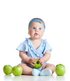 Adorable kid with green apples on white background Stock Photography