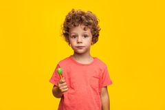 Adorable kid with lollipop Stock Photos