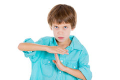 Adorable kid making a time out sign with his hands Royalty Free Stock Photo